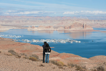 Couple overlooking Lake Powell and marina, Southwest USA
