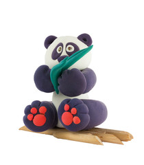 Souvenir. Panda sitting on the branches of bamboo.