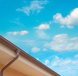 drainpipe under clouds poster