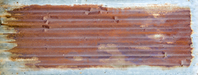 Full of rusty old tin roof.