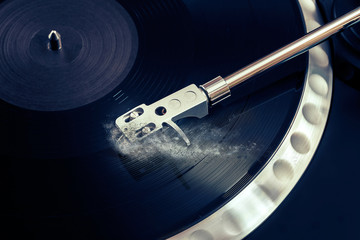vinyl laying on a record player - scratching the surface