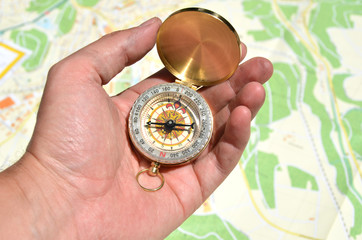Compass in the handgainst a map