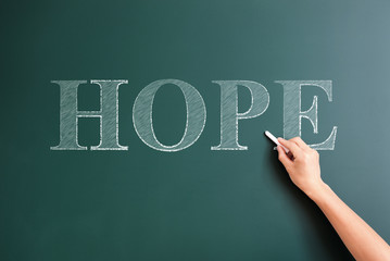 writing hope on blackboard
