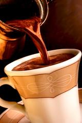 Pouring fresh Greek - Turkish coffee 1