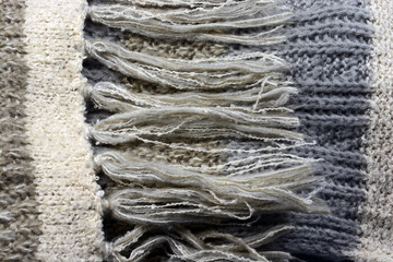 Background of knitted scarf in natural colors