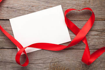 Photo frame or gift card with valentines heart shaped ribbon