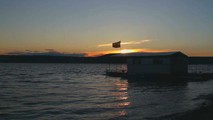 houseboat on a sunset
