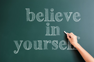 writing believe in yourself on blackboard