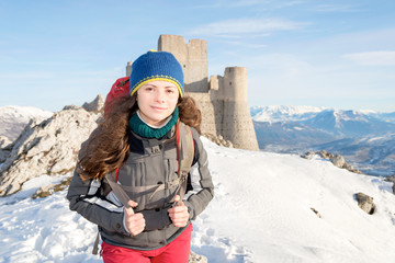 A joyful girl walking in the mountains, Abruzzo, Italy