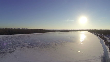 frozen river in winter with beautiful sun. Aerial