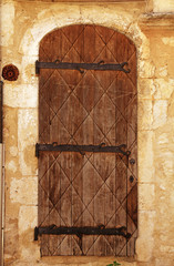 medieval door in rural stone wall house, Provence