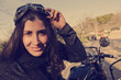 Woman biker portrait with vintage style filter
