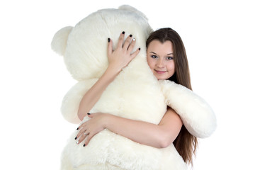 Portrait of hugging teddy bear girl