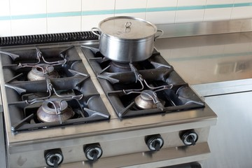 large pot over the stove of industrial kitchen