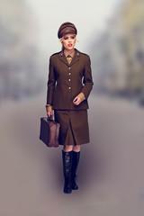 Elegant woman in a brown army uniform