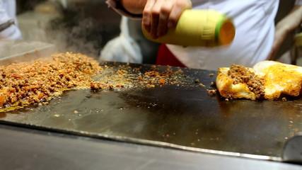 Chefs preparing Turkish Lamb intestine Kokorec for service