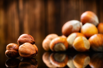Raw Organic Whole Hazelnuts on wooden background. Selective