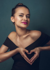 Beautiful woman show heart
