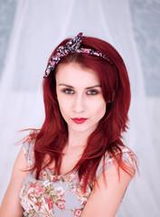 Pretty redhead woman in a floral dress