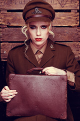 Glamorous intense young female army recruit