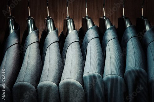 canvas print picture Row of men suit jackets on hangers