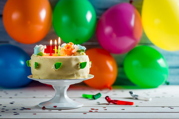 Party with balloons and a birthday cake