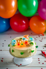 Sweet cake with candles on a birthday party