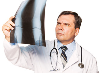 Mature male doctor radiologist studying patient's x-ray.