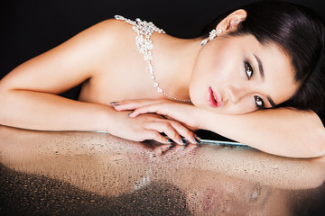beautiful sexy brunette asian model with luxury accessories and