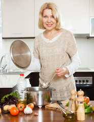 Mature housewife cooking  soup