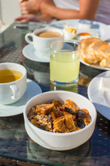 Delicious breakfast with flakes,dried fruit and cup of hot