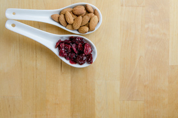 Spoons of Almonds and Cranberries with Copy Space