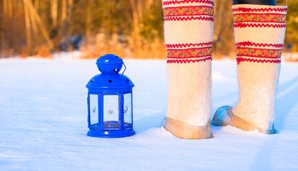 Closeup of beautiful vintage blue Christmas lantern on the snow