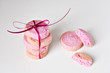 Raspberry pink cookies with ribbon on white background