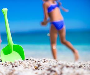 Summer kid's beach toy in the white sand