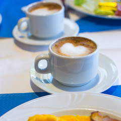 Delicious and tasty cappuccino for breakfast at a cafe