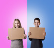 children with cardboard signs