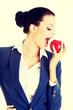 Young business woman with red apple.