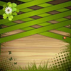 Wood background with clover and green strips
