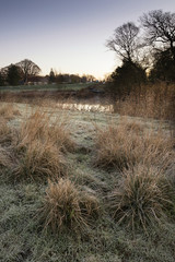 Landscape Winter surnise of river and frosty fields