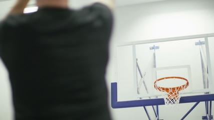 Basketball player scoring free throws in slow motion