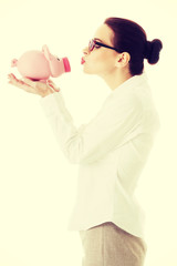 Beautiful business woman holding piggy-bank.