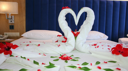 Romantic Flower Petal Arrangement on a Hotel Bed