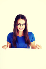 Beautiful casual woman holding copy space.
