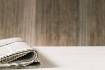Newspaper.On blank desk.