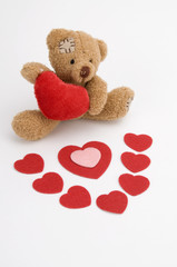 Valentine's Day Teddy Bear and Red Hearts