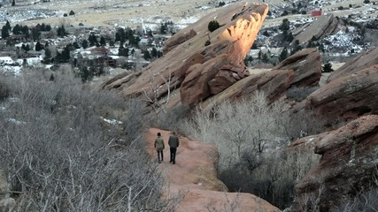 People hiking on a trail at Red Rocks Colorado