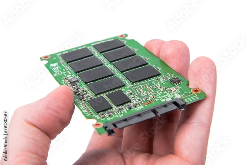 Opened solid state drive closeup - 76280567