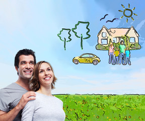 Couple thinking about new home and car.