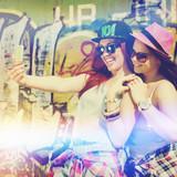 Fototapety Two teenage girlfriends taking a selfie with smartphone
